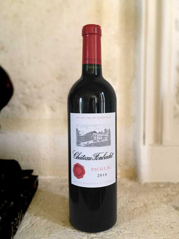 Bottle of Château Fonbadet red wine from the Bordeaux Region